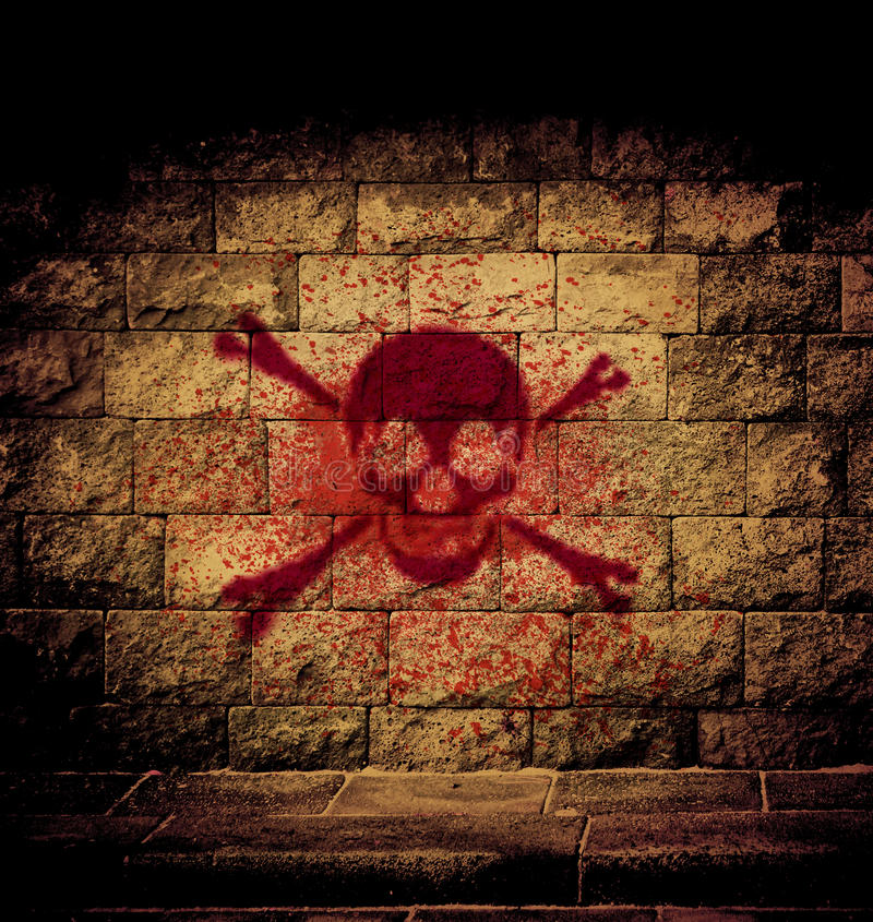 Skull blood. Paint at the brick wall with dim light stock illustration