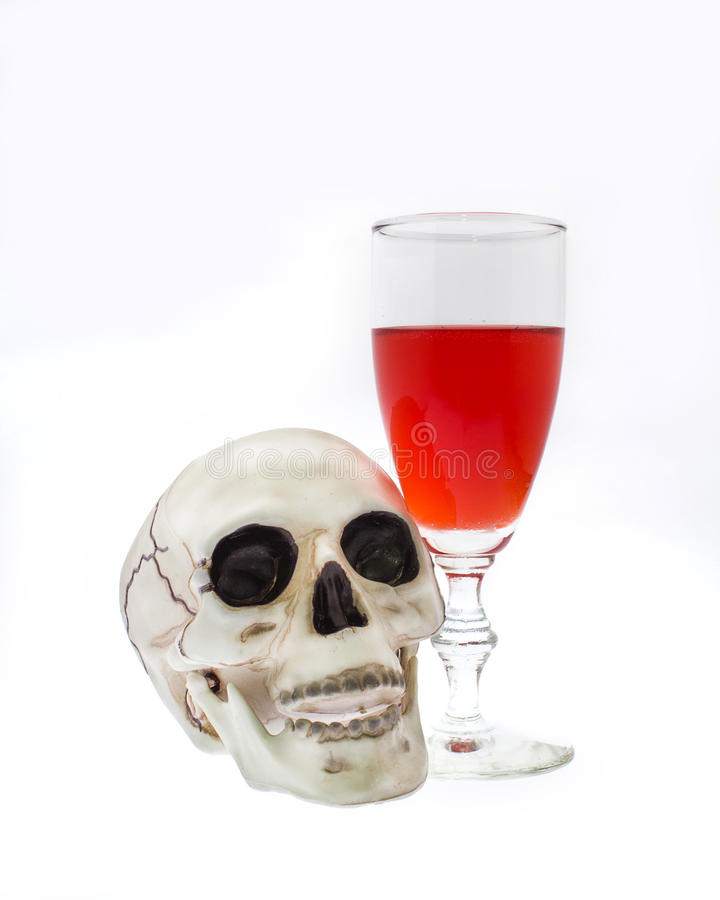 Skull with Blood Red Wine. Skull with red wine isolated on a white background stock photos