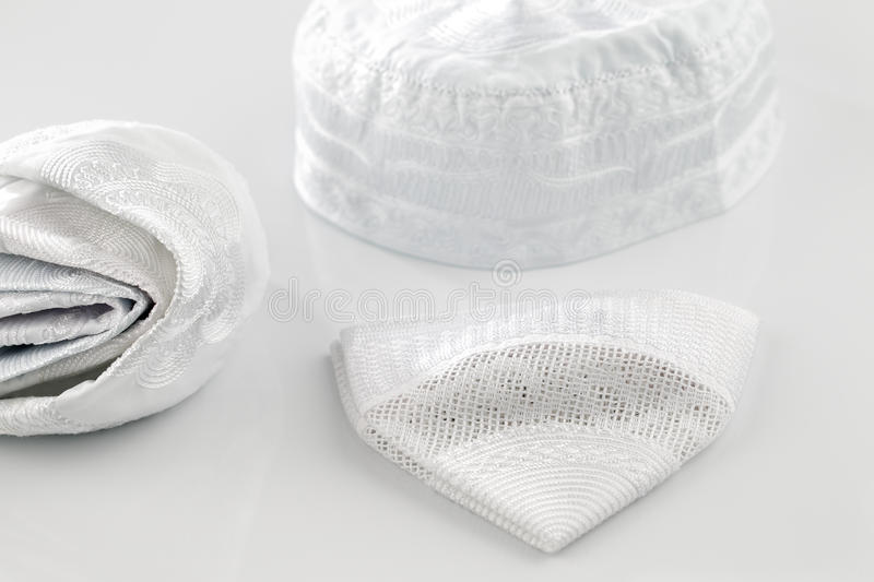 Skull caps are usually worn by Muslim men, sometim stock photography