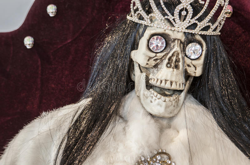Skull with a diadem and large diamonds. Wealthy and death concept royalty free stock photography