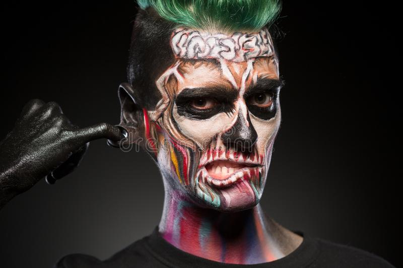 Skull face art, portrait of man with bright mystical makeup. royalty free stock photos