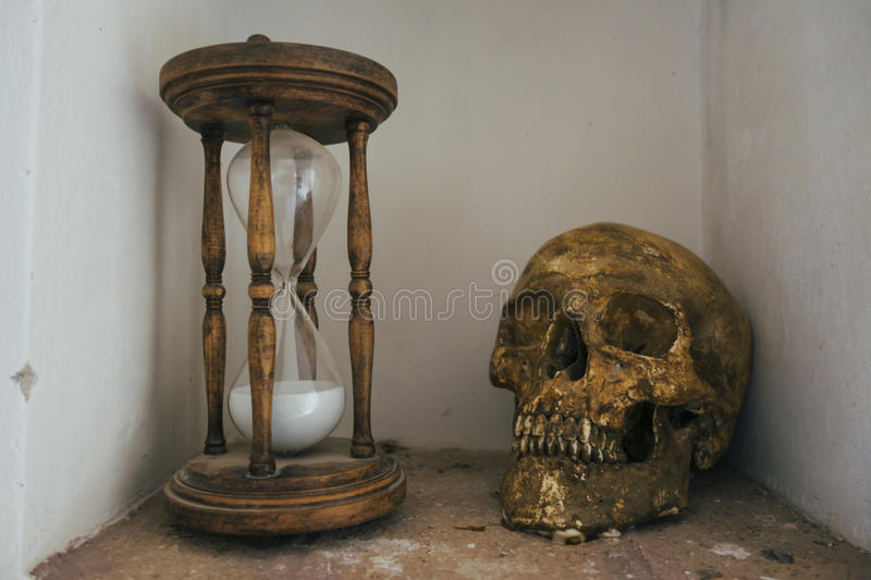 Skull and hourglass royalty free stock photos