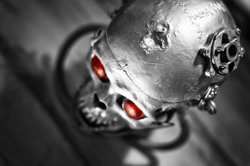Skull of a human size robot. In black and white stock photo