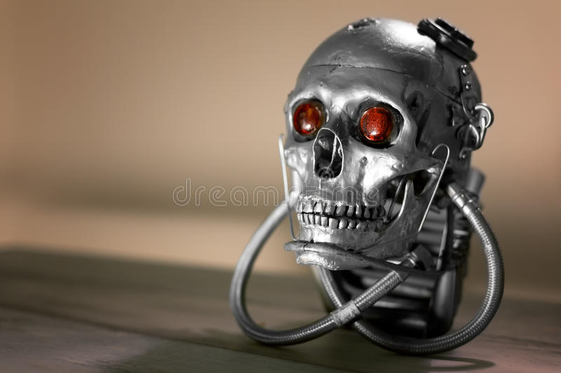 Skull of a human size robot. In black and white stock photography