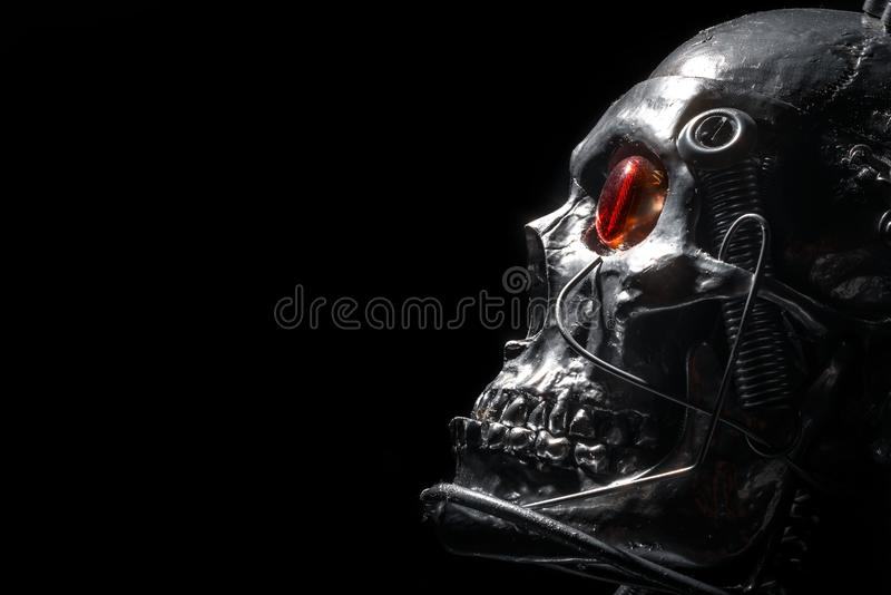 Skull of a human size robot. Isolated on black stock photography