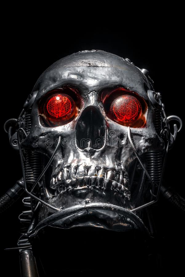 Skull of a human size robot. Isolated on black royalty free stock photography