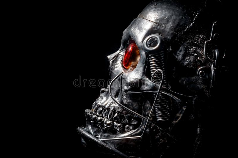 Skull of a human size robot. Isolated on black stock photos