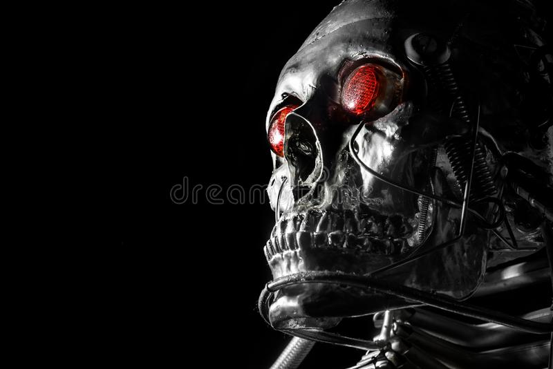 Skull of a human size robot. Isolated on black royalty free stock photos