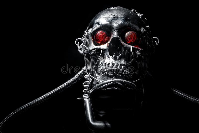 Skull of a human size robot. Isolated on black royalty free stock images