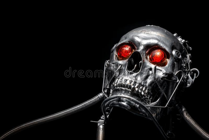 Skull of a human size robot. Isolated on black royalty free stock image