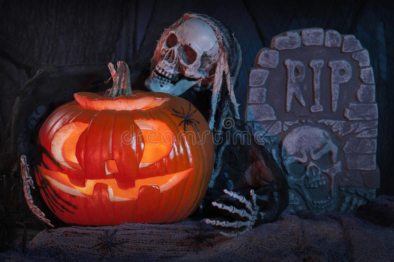 Skull monster and halloween pumpkin stock photos