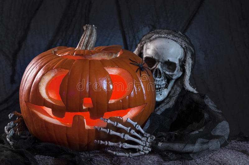 Skull monster and halloween pumpkin royalty free stock photos