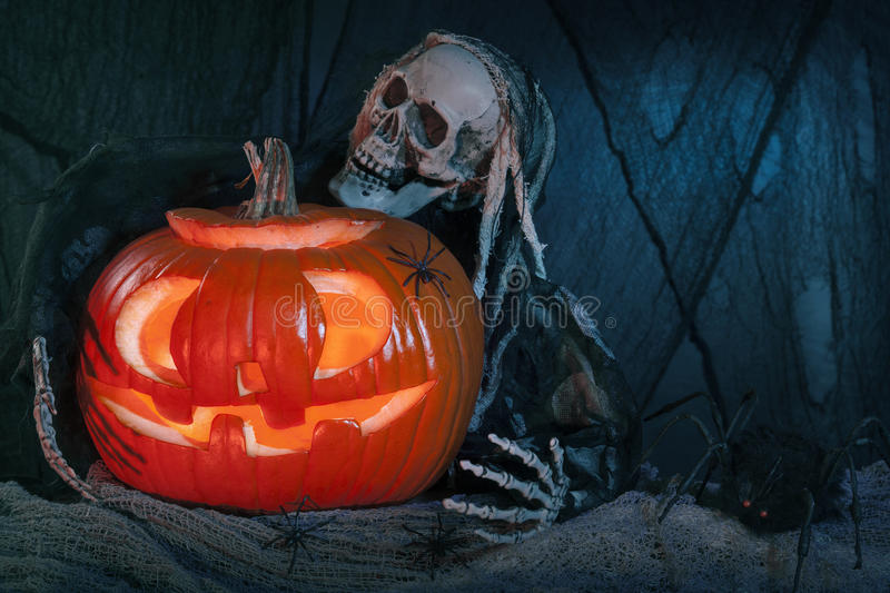 Skull monster and halloween pumpkin royalty free stock images