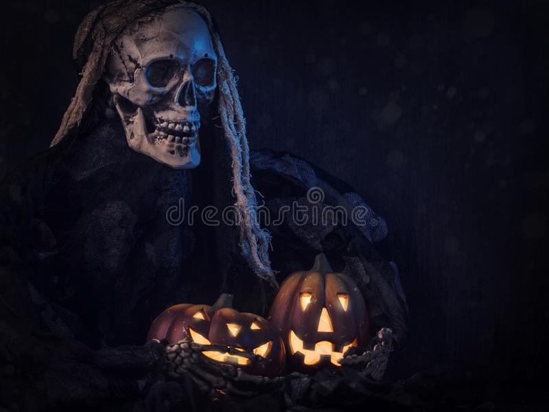 Skull monster and pumpkins stock image