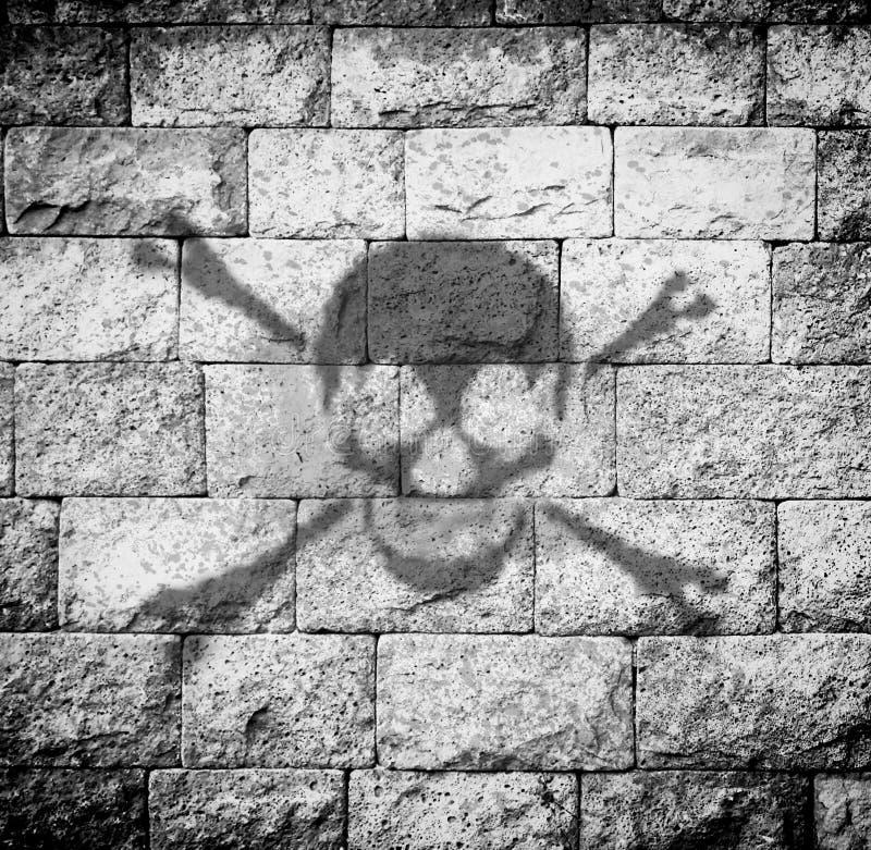 Skull paint. At the brick wall,gray color tone stock illustration