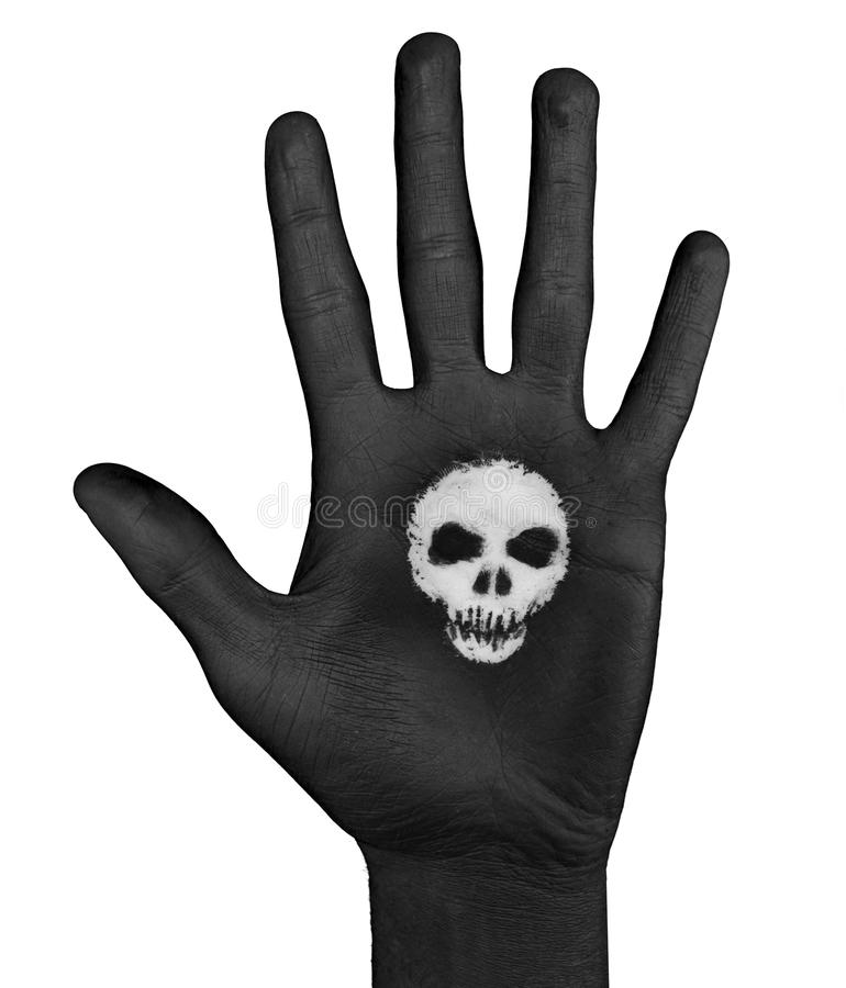 Skull In The Palm Of Painted Hand stock photo