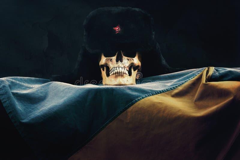 Skull with russian Ushanka on ukraine Flag. Skull with russian Ushanka on the ukraine Flag stock image