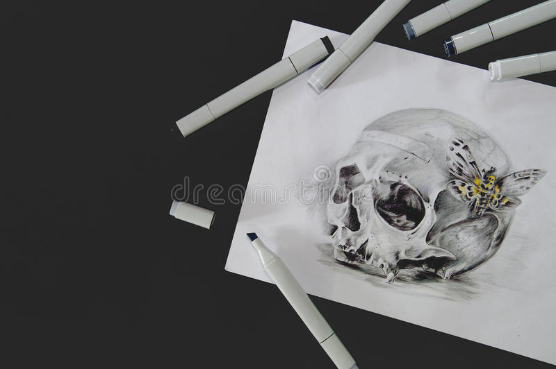 Skull tattoo sketch. Tattoo sketch of skull with felt pens on black background royalty free stock images