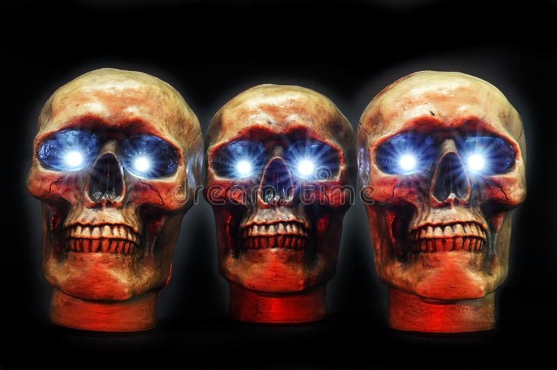 Skulls. Halloween party skulls with glowing eyes royalty free stock image