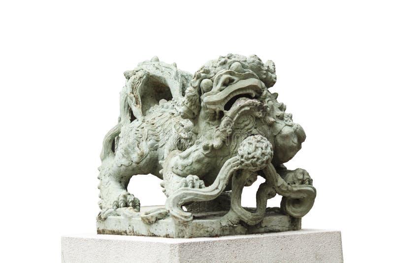 Skulptur av det kinesiska lejonet, antikt traditionellt snida för sten arkivfoton