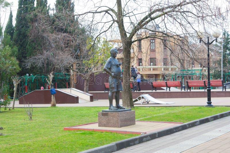 Skulptur av en turist med en kamera arkivbild