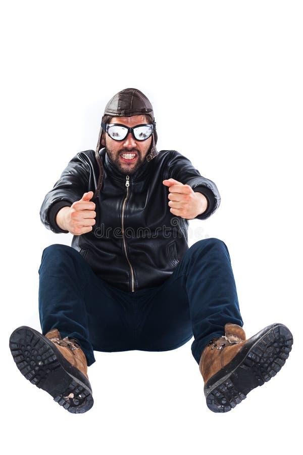 Skupiający się młody człowiek udaje jechać samochód fotografia stock
