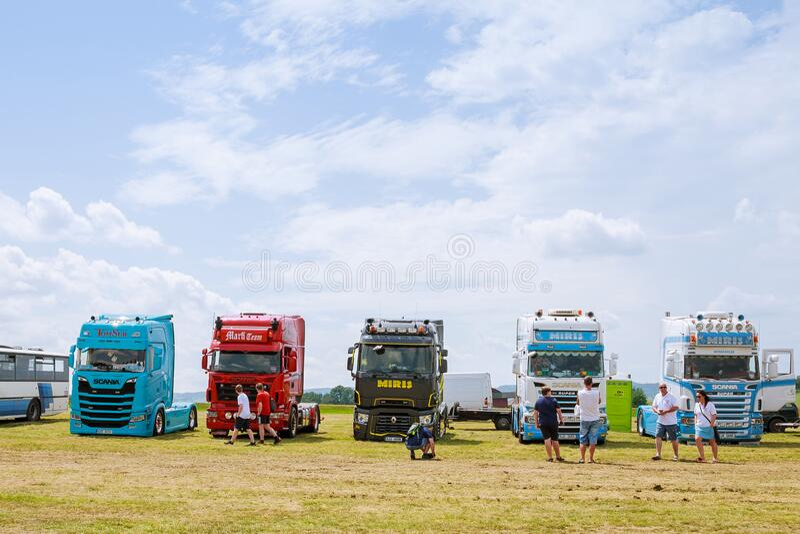 Skutech, Czech Republic, 26 June 2020: Drivers help children. Transport festival in the Czech Republic. Truck Show royalty free stock photos