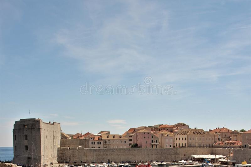 The sky above the fortress walls of Dubrovnik, Croatia. Sky and clouds over the city of Dubrovnik, Croatia, on a sunny day. Beautiful blue sky with light white royalty free stock images