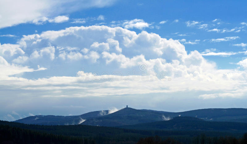 Sky above landscape. View of clouds above wood mountainous landscape stock photography