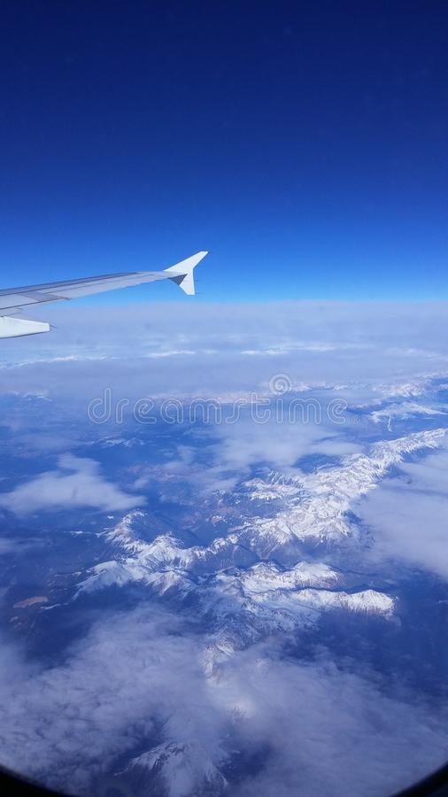 Sky above_snowy mountains stock images