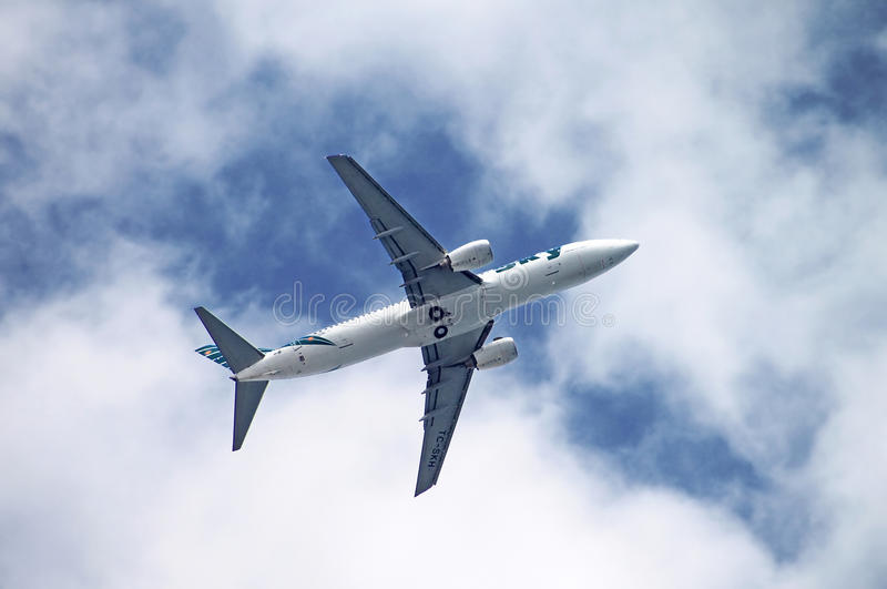 Sky Airlines Boeing 737-800 is flying over Antalya, Turkey. Sky Airlines was an airline which operated chartered flights. It was based in Antalya, Turkey stock photography