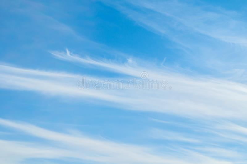 Sky background. Blue sky landscape with dramatic sunset clouds lit by evening sunset light. Evening sky view stock photo