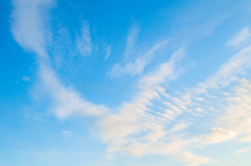 Sky background. Blue sky landscape with colorful sunset clouds lit by evening sunset light. Evening sky view royalty free stock photography
