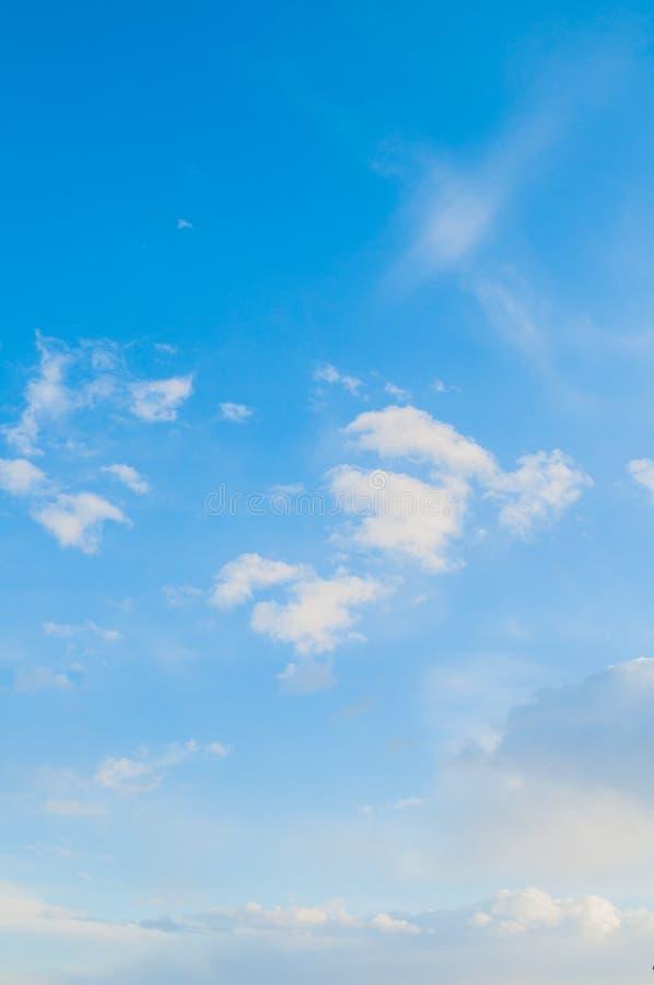 Sky background. Blue sky landscape with dramatic sunset clouds lit by evening light. Sky background. Blue sky landscape with dramatic sunset clouds lit by royalty free stock photo
