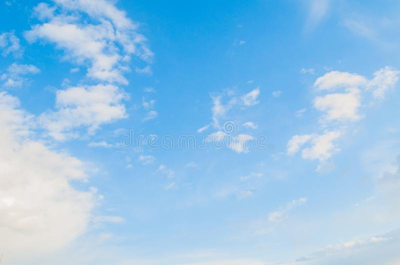 Sky background. Blue sky landscape with dramatic sunset clouds lit by evening light. Sky background. Blue sky landscape with dramatic sunset clouds lit by stock images