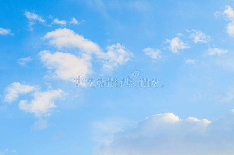 Sky background. Blue sky landscape with pastel sunset clouds lit by evening sunset light. Evening sky view royalty free stock images