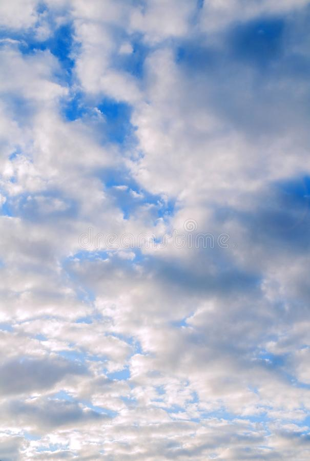 Sky background. Blue sky landscape with picturesque sunset clouds lit by evening sunset light. Evening sky view stock images
