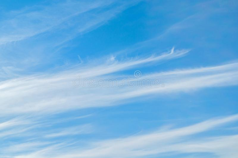 Sky background - dramatic sunset clouds lit by evening sunset light. Evening sky view stock photography