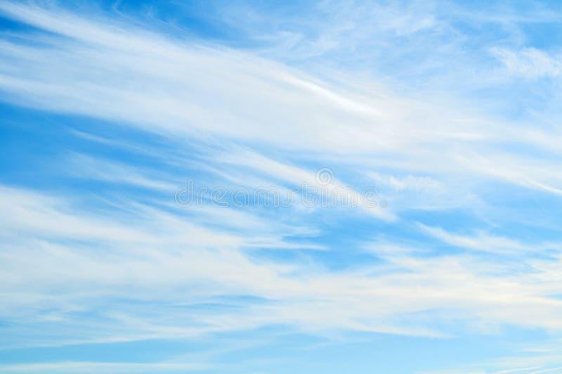 Sky background - dramatic sunset clouds lit by evening sunset light, sunny sky view. Sky background - dramatic sunset clouds lit by evening sunset light, evening stock image