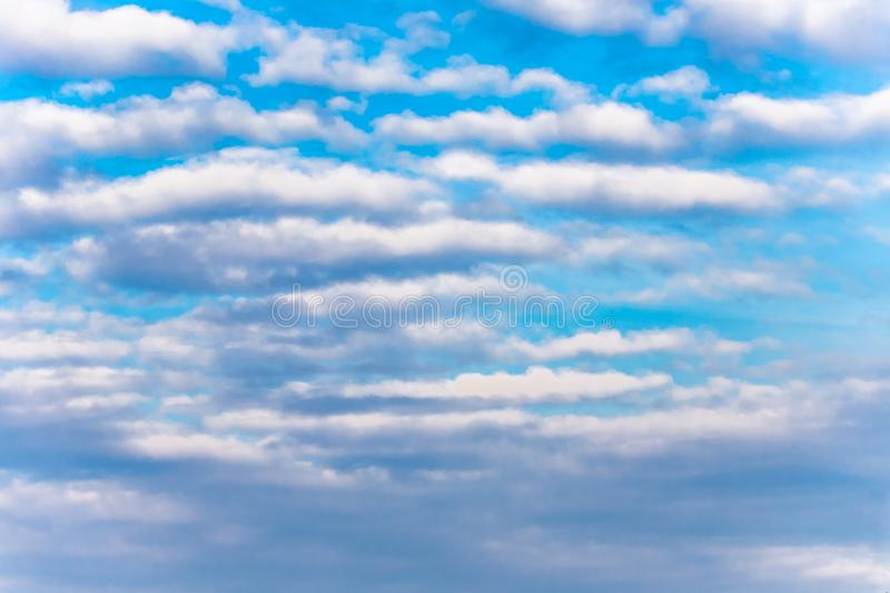 Sky background. White clouds on bright blue sky stock photo