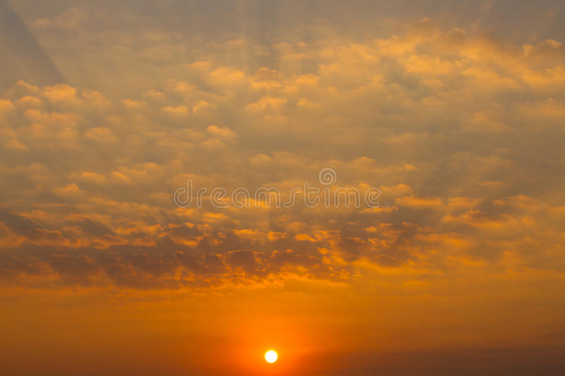 Sky with beautiful clouds and rising sun, horizontal royalty free stock photo