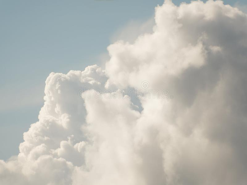 The sky with beautiful cumulus clouds. Restrained pastel colors royalty free stock images