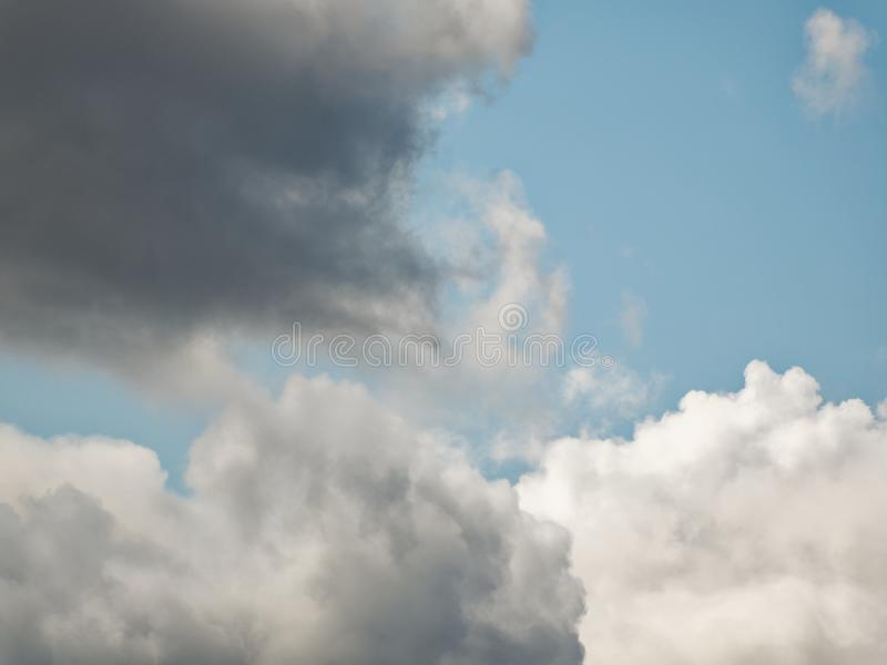 The sky with beautiful cumulus clouds. Restrained pastel colors royalty free stock photos