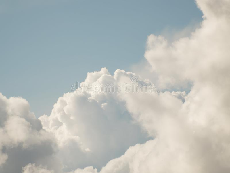 The sky with beautiful cumulus clouds. Restrained pastel colors royalty free stock photography