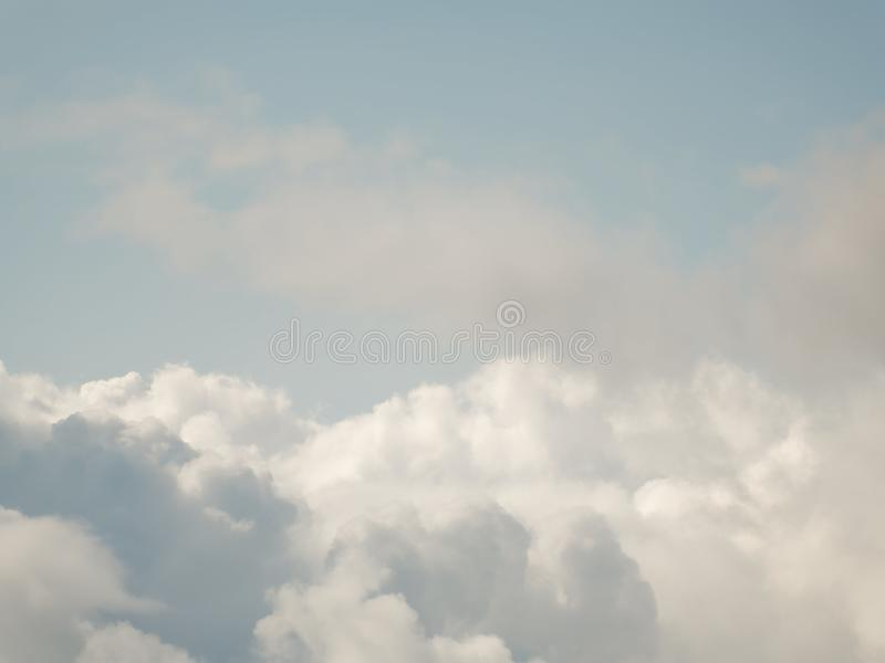The sky with beautiful cumulus clouds. Restrained pastel colors stock images