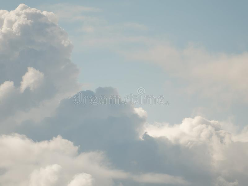 The sky with beautiful cumulus clouds. Restrained pastel colors stock photography