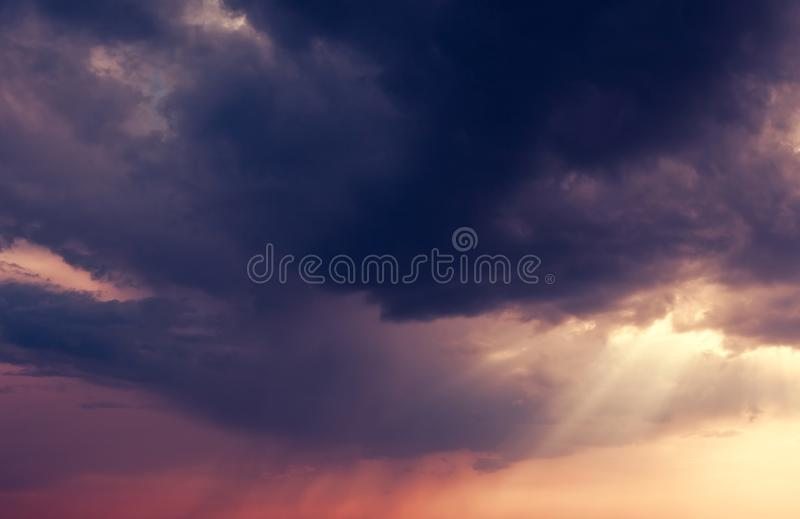 Sky. Beautiful nature background. Fantastic colorful sunset and dark ominous clouds. Beauty world stock photo