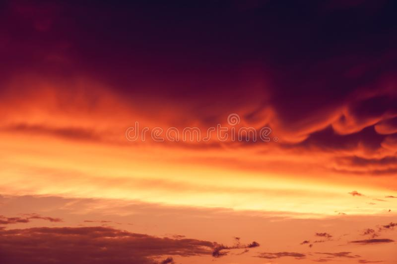 Sky. Beautiful nature background. Fantastic colorful sunset and dark ominous clouds. Beauty world royalty free stock photo