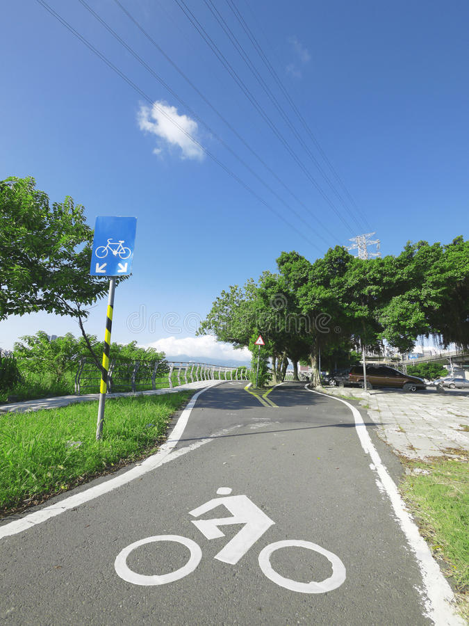 Sky and bicycle way. In the park stock photography