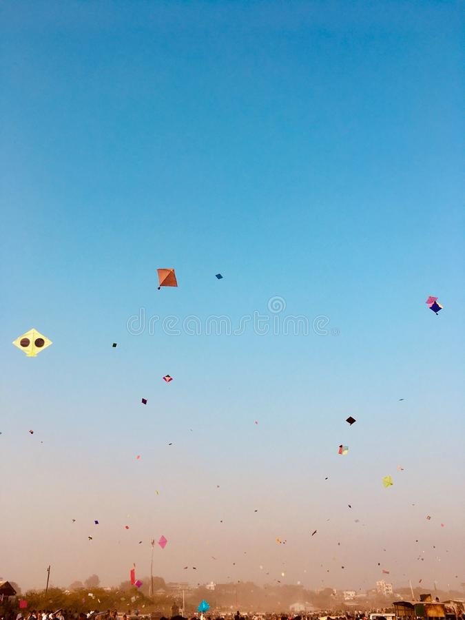 Sky blue colourfully kites stock photos